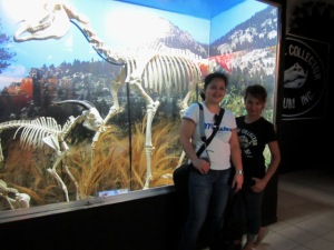Ann Ann and I posing with a mother and baby horse skeletons at the back