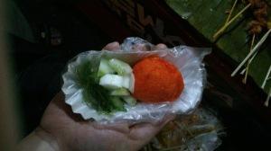 kwek-kwek with vinegar, cucumbers and seaweed