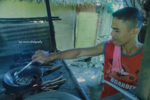Kuya preppin luch for the family. He is a masseuse in Davao City.